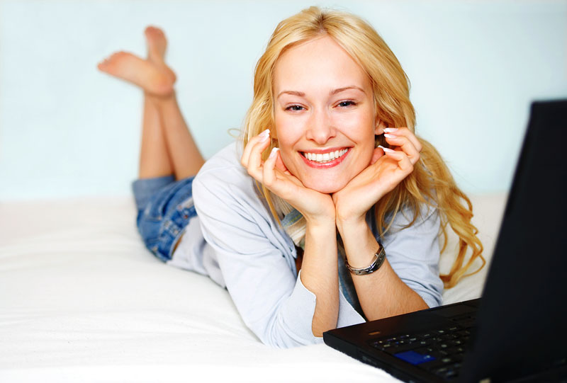 bigstockphoto_beautiful_woman_in_bed_with_la_1658362