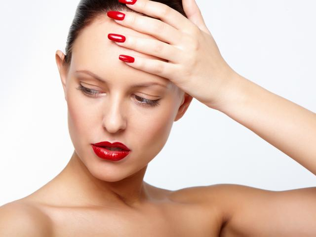 tired_woman_holding_head_shutterstock__medium_4x3