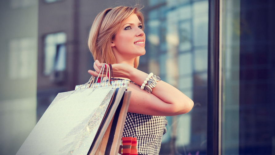 Happy-young-woman-with-shopping-bags-3
