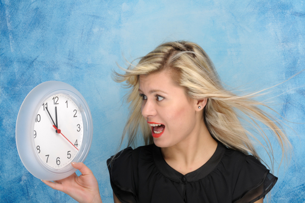 stressed-woman-with-clock